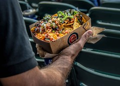 Who's Hungry? (Wes Iversen) Tags: chicago chicagocubs illinois mexicanfood nachosgrande wrigleyfield wrigleyville ballparkfood baseball food hand men nachos people seats sports