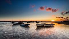 Brancaster Sunrise (Mark Lindstrom) Tags: boating leefilter 818 panasonicleica em1mk2 olympus blue brancaster norfolk moored harbour coast water boats sunrise