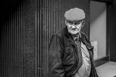 Lines (Leanne Boulton) Tags: portrait hat urban street candid portraiture streetphotography candidstreetphotography candidportrait streetportrait streetlife old elderly man male face eyes bunnet lines checks tartan pattern tone texture detail depthoffield bokeh naturallight outdoor light shade city scene human life living humanity society culture lifestyle people canon canon5dmkiii 50mm ef2470mmf28liiusm black white blackwhite bw mono blackandwhite monochrome glasgow scotland uk
