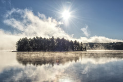Perfection in reflection (mystero233) Tags: reflection lake water muskoka ontario canada america tree trees forest island mist fog morning sunrise dawn blue sky clear sun light rays landscape outdoor nature beauty