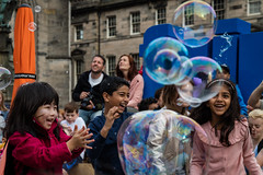Edinburgh Festival Fringe 2018-116 (Philip Gillespie) Tags: edinburgh scotland festival fringe summer gardens sky sun clouds colours green yellow blue white black red purple orange pink water canon 5dsr photography color urban 2018 bright colourful wet outdoor outside people men women man woman kids children boys girls families crowds street performances acts comedians hoola hoop juggling fire flames eyes feet hands heads faces hair city centre royal mile castle tron joy pleasure happy happiness magic bubbles bursting magicians cabaret costumes makeup hats