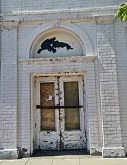 Bar the Doors, Saginaw, MI (Robby Virus) Tags: saginaw michigan mi door entry entrance abandoned bar barred front derelict