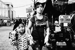 Kiss Mark (Meljoe San Diego) Tags: meljoesandiego fuji fujifilm x100f streetphotography mother daughter candid monochrome philippines