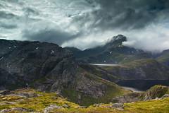 At the feet of Hermannsdalstinden (ahimsia) Tags: lofoten norway mountains lake moskenesøya clouds landscape outdoors hiking backpacking hermannsdalstinden