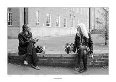 The space between (AnthonyCNeill) Tags: street photography outdoor women candid black white schwarz weiss blanco negro noir blanc fujifilm x100f conversation talking lunch break town city derby stadt elcentro ville sitting seated smoking cigarettes wall building windows