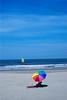 Strand (tiltdesign2016) Tags: olympusom2n zuiko50mm diafilm fujifilmfujichrome100asa niederlande holland nederland strand sonne sonnenschirm bunt nordsee plustekopticfilm7600ise segelschiff himmel fujivelvia100