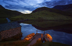 Rowing Boats by Moonlight, Llyn Y Dywarchen, Snowdonia North Wales (MelvinNicholsonPhotography) Tags: llynydywarchen northwales snowdonia wales tarn moonlight nighttime night longexposure rowingboats boats boatshed