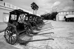 Rickshaws . . (grantthai) Tags: rickshaws thailand kanchanaburi mono bw old style