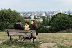 Parly Hill (Nad) Tags: couple family summer trees england hampsteadheath london park bench three