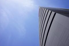 Yanmar Flying-Y building (Eric Flexyourhead) Tags: umeda 梅田 kitaku 北区 osaka osakashi 大阪市 kansai 関西地方 japan 日本 city urban cityscape architecture yanmar yanmarflyingybuilding bluesky blueskies sonyalphaa7 zeisssonnartfe35mmf28za zeiss 35mmf28