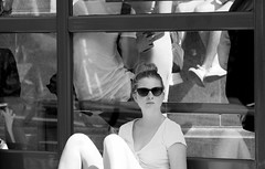 Waiting at bus-stop (John (Thank you for >2 million views)) Tags: 7dwf monochrome bw woman mujer mulier sitting sunglasses emotion look