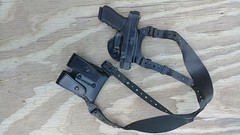 Gould and Goodrich Gold Line Shoulder Holster with Gun and Clip Bag on a Table (huntingmark) Tags: gould goodrich gold line shoulder holster with gun clip bag table edc glock pistol 1911 sw leather holsters magazine ccw