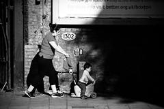 IMG_5451 (JetBlakInk) Tags: brixton magichour mono subject2ground motherandbaby mother streetphotography lowkey