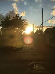 August Sunset 1 (sjrankin) Tags: 17august2018 edited view road clouds trees sun sky sunset kitahiroshima hokkaido japan