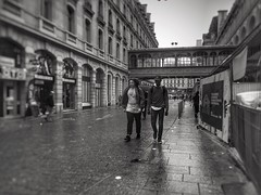 Exploring the city (LUMEN SCRIPT) Tags: dof softfocus focus streetphotography france paris city people street blackandwhite wet rainy monochrome rain water reflection