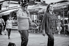I've Got The Music In My Head (Alfred Grupstra) Tags: people blackandwhite street urbanscene men outdoors citylife women editorial walking city crowd lifestyles groupofpeople summer ohrid macedonia