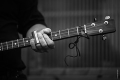 Cigar box guitar (Ivan Herrador) Tags: blackandwhite monochrome instrument electric guitar technique art music jam session method notesandchords fingering performance livemusic playing rock nikon nikkor180mmƒ28ai nikkor primelens nikond3s blackwhite black feeling ratelachmusicsessions cigarboxguitar