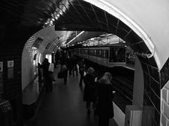 Reading while waiting (LUMEN SCRIPT) Tags: urban urbanphotography france paris life city candid streetphotography people metrostation metro monochrome
