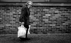 2018_170 (Chilanga Cement) Tags: fuji fujix100f fujifilm xseries x100f 100f bw blackandwhite bricks man shopping shadows monochrome walking sidewalk pavement preston prestonstreetphotography blogpreston wisdom