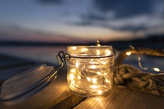 Little lights (Melanie Martinu) Tags: creative outdoor evening water sigmaart canon germany bavaria light colorful colors clouds sky lake landscape bokeh lights glass nature sunset