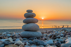 Zen pebbles standing on the beach at sunset (arnaud_martinez) Tags: back balance beach blue harmony heap landscape nature ocean people relaxation sky summer sun sunset water calm calming concept five ground inspiration meditation orange pebble pebbles pure pyramid relaxing rock sea stability stack stone stones sunrise symbol tower tranquil walk waves yoga zen