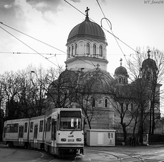 Spirit of Bucharest (WT_fan06) Tags: tram bucharest city urban bw blackandwhite bnw monochrome sky light church contrast aperture photography nikon d3400 dslr mood atmosphere bright v3a ratb 262 tracks lines wires rumanien bukarest schwarz weiss noir blanche old 7dwf flickr central centre bucuresti artsy artistic aesthetic bahn haltstelle zug zentrum kirche strassenbahn faur grey tones public transport transportation rails street road center cityscape landscape head texture blancoynegro white black clouds clear