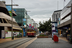 Here Comes the Tram (Jocey K) Tags: newzealand nikond750 christchurch cbd building architecture trees people street tram postbox rebuild sky