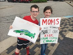 Kids with their signs outside the Ford Building while dropping off petitions