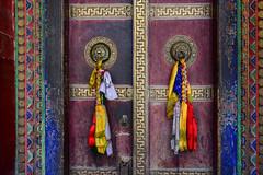 Door of Gompa in Tibetan monastery (phuong.sg@gmail.com) Tags: buddhism buddhist building culture delhi detail door doorknob doorway entrance exit gate gateway gompa grunge hand handle himachal india indian jammu kashmir ladakh leh metal monastery north ornate place portal pradesh religion religious retro scenery symmetric symmetry tassel temple tibet tibetan valley vintage worship