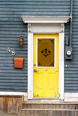 Yellow Door (Karen_Chappell) Tags: door house nfld newfoundland downtown stjohns rowhouse jellybeanrow blue yellow architecture building city urban canada eastcoast atlanticcanada avalonpeninsula mailbox trim paint painted wood wooden white steps entrance red window colourful colours multicoloured colour color