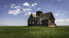 Fluffy Gothic (Flint Roads) Tags: kremlin mt milkrivervalleychurch montana usa abandoned blue bluesky church clouds decay deteriorated field forsaken gothic grass green old rural white wood