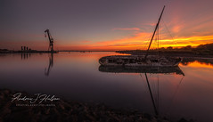 The Old Wreck At High Tide (Andrew J Hulson) Tags: hampshire boats boatgraveyard boatwithnoname harbour tipner sunset beautifulsunset reflectionsinthewater stillwater nikond810 longexposure wooden ships wreck wrecksinthesolent 1635mm unitedkingdom