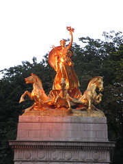 Orange Sunset Victory Statue - USS Maine Monument 4230 (Brechtbug) Tags: orange sunset victory statue maine monument 1914 beaux arts commemorating sinking battleship 1898 sculpted representations mythological figures peace courage fortitude justice central park entrance nyc 06252018 new york city statues group sculpture sculptures art golden gold leaf woman horses hippocampus seahorse hippocamp sea horse giant clam shell sled coach chariot mythology columbus circle architect h van buren magonigle sculptor attilio piccirilli 1901 1913