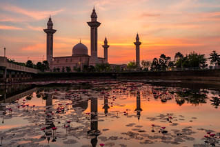 Sunrise scene of majestic Jelutong Mosque or Masjid Tengku Ampuan Jemaah with reflection at Kuala Lumpur Malaysia