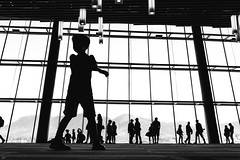 lost in the crowd (bluechameleon) Tags: sharonwish blackandwhite bluechameleonphotography canada canadaplace city crowd downtown indoors lights lines monochromatic mountains people silhouette silhouetted summer urban vancouver waterfront window