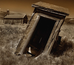 The Leaning Tower of Privy (CameraOne) Tags: privy outhouse toilet leaning sepia monochrome blackandwhite raw cameraone bodie ghosttown ruins urbandecay desolate abandoned canon6d canonef1740mm wideangle california statepark historic arresteddecay owensvalley