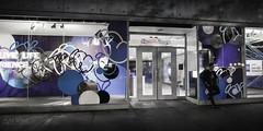 Inner City Blues (wilbias) Tags: blue black white toronto street standing american express wide aspect ratio