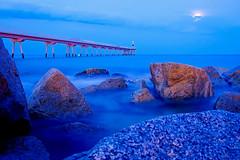 At nightfall - Pont del Petroli (Fnikos) Tags: sea water mar mare wave rock bridge puente pont sky skyline moon light cloud people nature outdoor