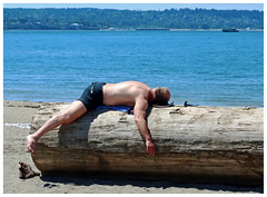 Log Love (HereInVancouver) Tags: man beach relaxed log lyingfacedown notlaying candid ocean water pacific vancouverswestend thingstodobythewater englishbaybeach vancouver bc canada canong3x city urban loglove