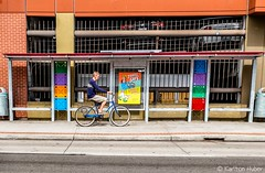 Travel Safe (www.karltonhuberphotography.com) Tags: 2018 bicycle bicyclist busstop citystreets downtown horizontalimage karltonhuber man parkingstructure peoplewatching riding santaana sign southerncalifornia streetphotography streetscene urban