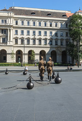 Marching in Budapest (Marian Pollock) Tags: budapest europe parliament kossuthlajoster soldiers marching bollards architecture tree windows hungary pest two square people sunny arches