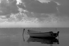 Sea, boat and clouds (www.holgersbilderwelt.de) Tags: nature white light sky water black travel landscape summer sea beach morning art ocean reflection island pretty europe coast outdoor monochrome fine shadow amazing classic kunst weather scenic lovely tranquility historic season culture calm countryside traditional peace perspective waterscape baltic schwarzweiss aperture