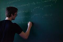 Mathematician (Jeremy Caney) Tags: blue calculus chalktalk chalkboard diffeq differentialequations diffyq equations grainy mathematicians mathematics maths pat presentation seattleuniversity students talks