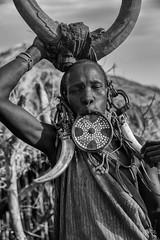 Mursi (Rod Waddington) Tags: africa african afrique afrika äthiopien ethiopia ethiopian ethnic etiopia ethnicity ethiopie etiopian omovalley outdoor omo omoriver outdoors mago makki mursi tribe traditional tribal blackandwhite monochrome mono village hut costume native woman