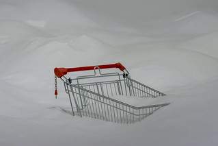 A shopping trolley in a pile of sugar