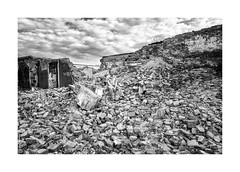 Lost in the rubble (Paphylo) Tags: leicaq people outdoor monochome świebodzice behindthescene ruins wreckage rubble figure marketplace blackandwhite thepaintedbird poland debris rest document