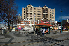 Waiting for the Tram (Jocey K) Tags: cathedralsquare newzealand nikond750 christchurch cbd city architecture buildings trees shadows sky clouds people