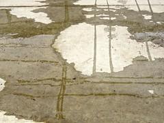 Minimalism (Chic Bee) Tags: puddle shoppingcarttracks footprints floor cement concrete surreal minimalist minimalism modernart impressionism tracks