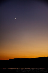 Setting Moon, Setting Sun . . . with Venus in Conjunction (LongInt57) Tags: landscape sky astronomy sunset water lake mountain hill waxing crescent moon planet venus conjunction glow blue yellow golden orange white black kelowna bc canada okanagan
