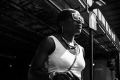 Up (markfly1) Tags: woman walking black pride blackpride parade london england uk vauxhall sunglasses street candid mono monochromatic white bw baw dark shade bright light high contrast d750 35mm manual focus lens